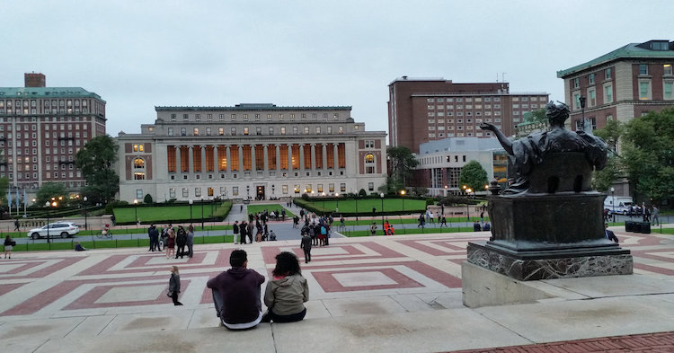 image of students in front of a university library