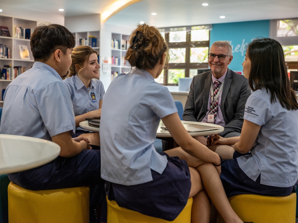 students with a counsellor at the British International School Ho Chi Minh City